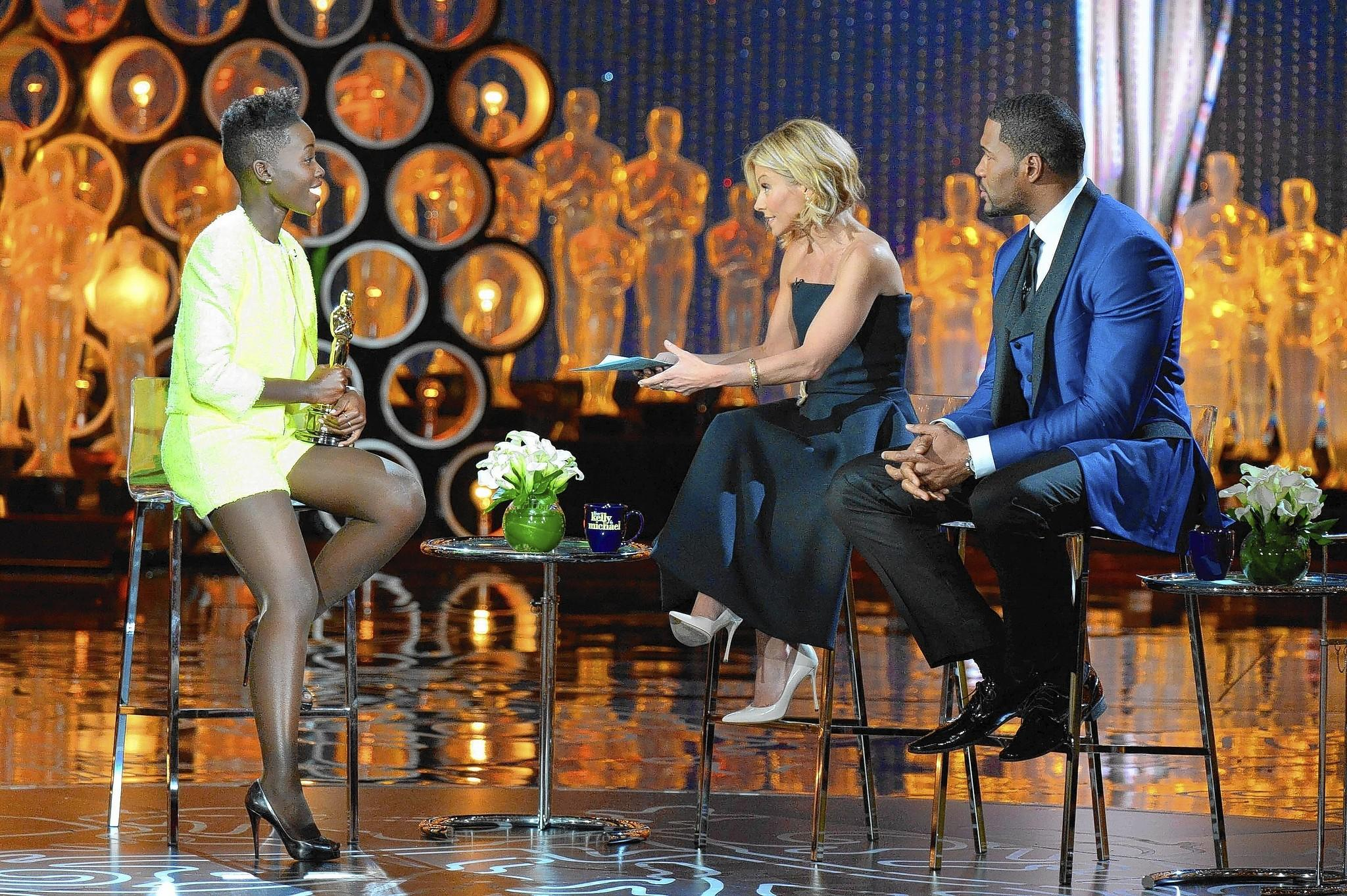 "Oscar winner Lupita Nyong'o, left, got little rest following her big night before going on ""Live"" with Kelly Ripa and Michael Strahan."