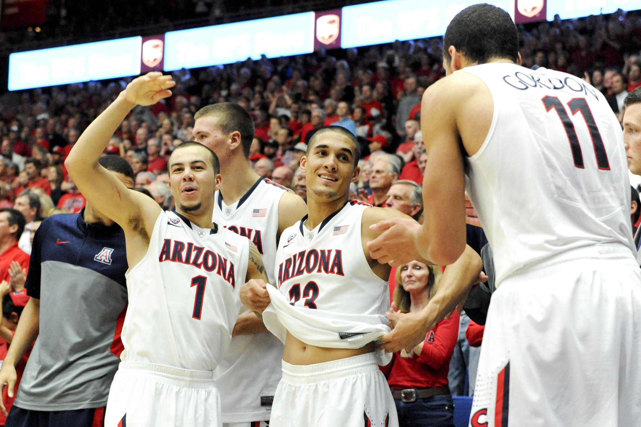 Arizona's Gabe York and Nick Johnson celebrate on the bench during the second half.