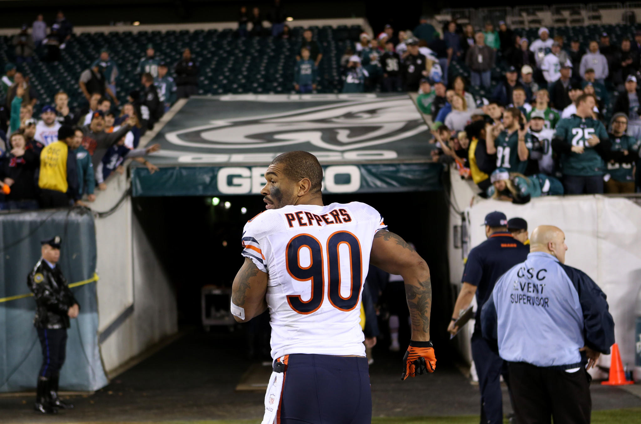 Bears defensive end Julius Peppers runs off the field after losing to the Eagles.
