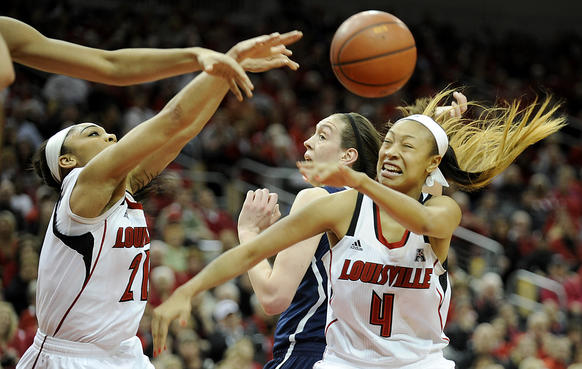 Louisville guards Bria Smith, left, and Antonita Slaughter get position for a rebound on UConn forward Breanna Stewart during the first half.