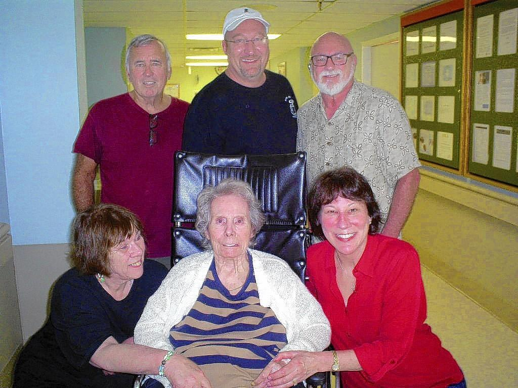 Becky Bechtel, bottom right, connected with family members she hadn't previously met. Top, from left, Jim Lander, Al Manfredi and Tom Lander. Bottom, from left, are Susan Lander and Helen Manfredi, mother of the children.