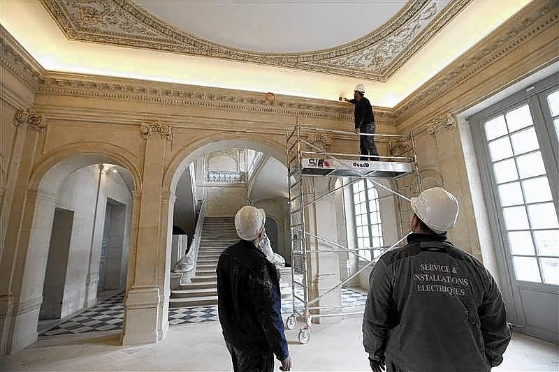 Workers put the final touch during the renovation of the Hotel Sale known as the Picasso Museum in the Marais district of Paris.