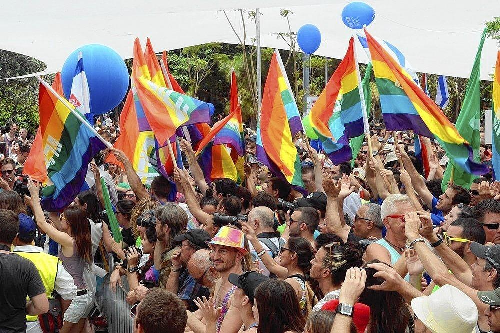 Tel Aviv's lesbian, gay, bisexual and transgender community enjoys the LGBT parade in June of last year.