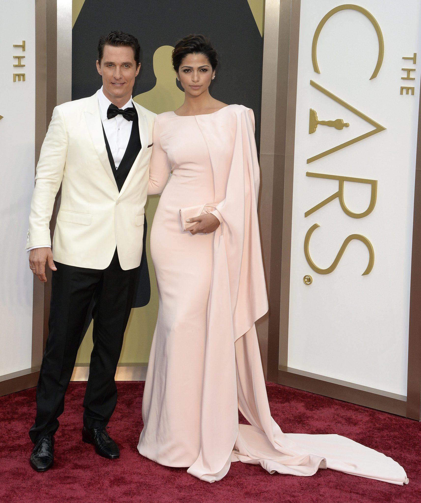Matthew McConaughey and Camila Alves-McConaughey arrive for the Academy Awards ceremony.