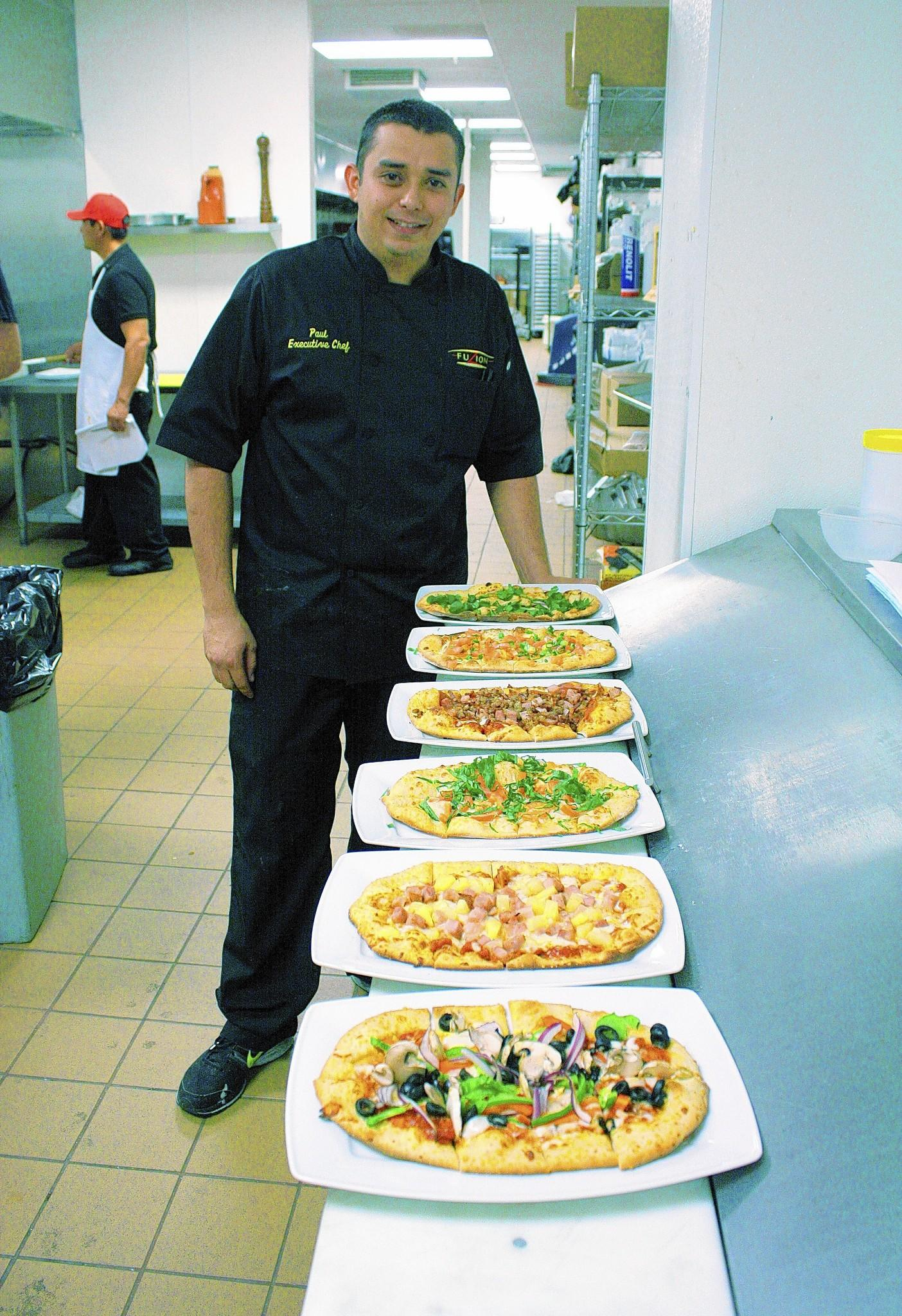Executive Chef Paul Setola with some of his homemade pizzas.