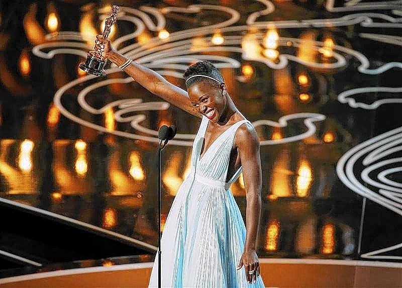 """Lupita Nyong'o, best supporting actress winner for her role in """"12 Years a Slave"""", speaks on stage at the 86th Academy Awards in Hollywood."""