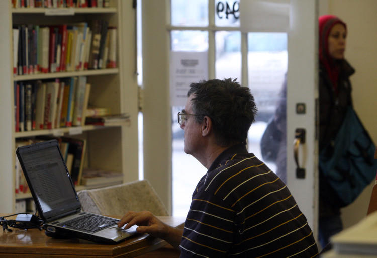 A computer user works on his lapto, using the free Wi-fi at the Evanston South Library.
