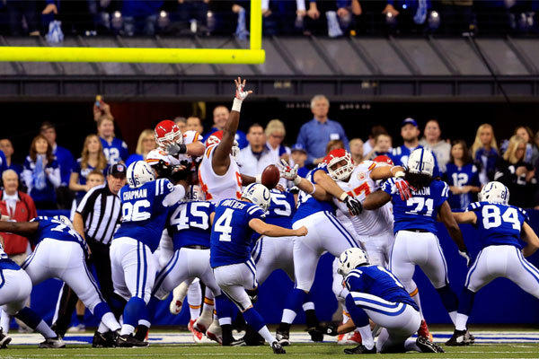 Indianapolis' Adam Vinatieri kicks an extra point against the Kansas City Chiefs during a wild-card in January.
