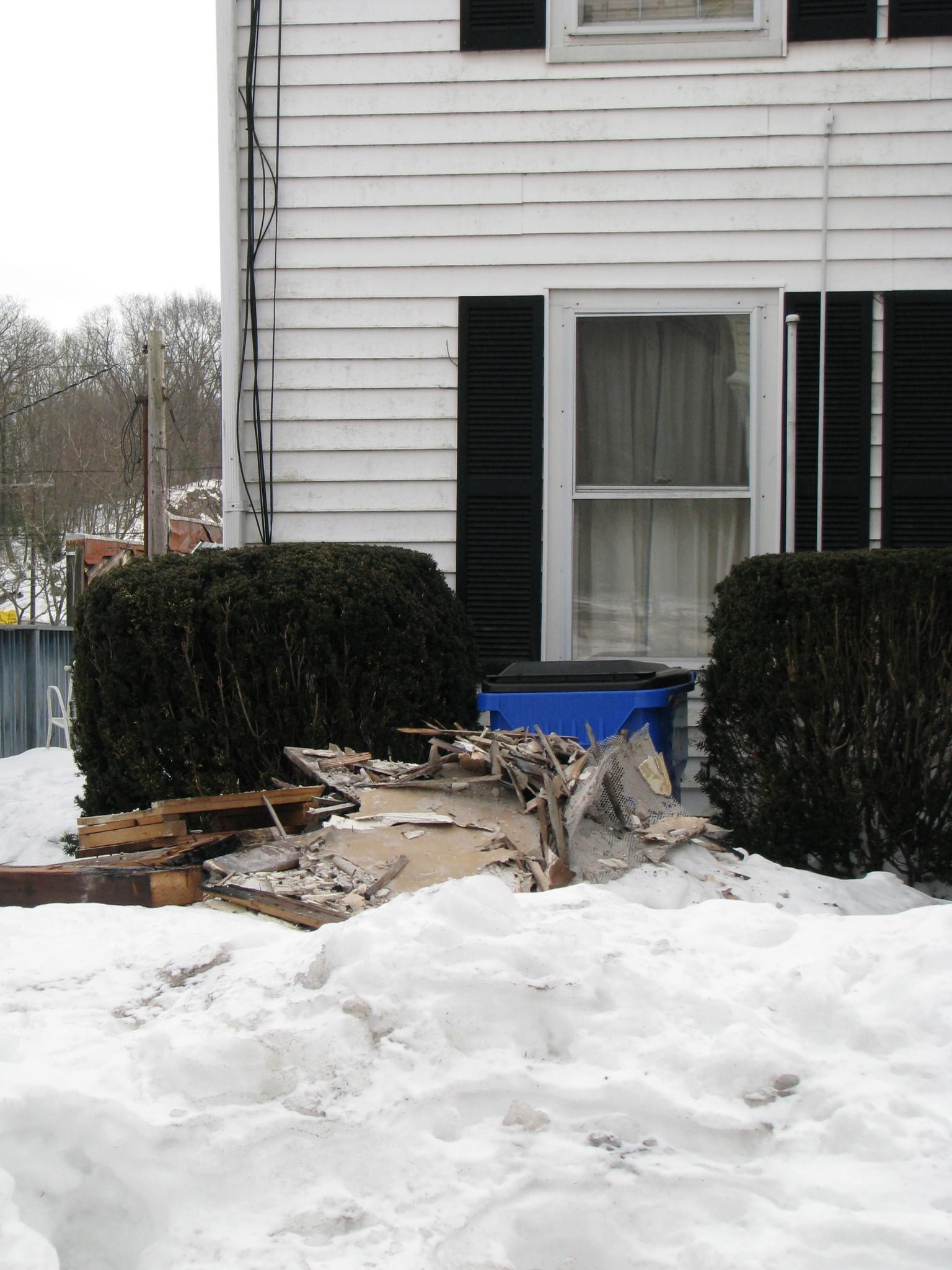 Debris leftover after Canton firefighters put out a fire at a house at 52 Bridge St. on March 2.