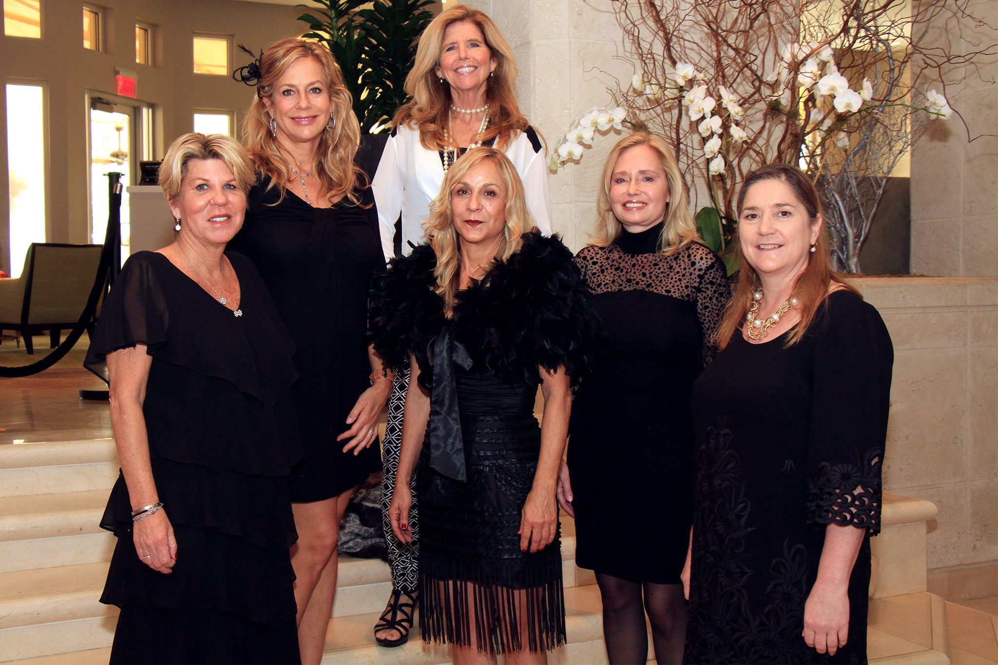 "Society Scene photos - In classic black garbs, Kim Koslow, front left, Elle DuPree, Lynn Gentithes and Linda Kane; Lavinia Baker, back left, and Mo Maynor prepare for the sixth annual ""Gratitude House Gala,"" to take place March 29 at 6 p.m. at the Four Seasons Resort in Manalapan."