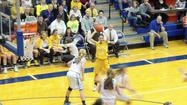 Girls hoops | Carmel meets goal, will hang sectional banner