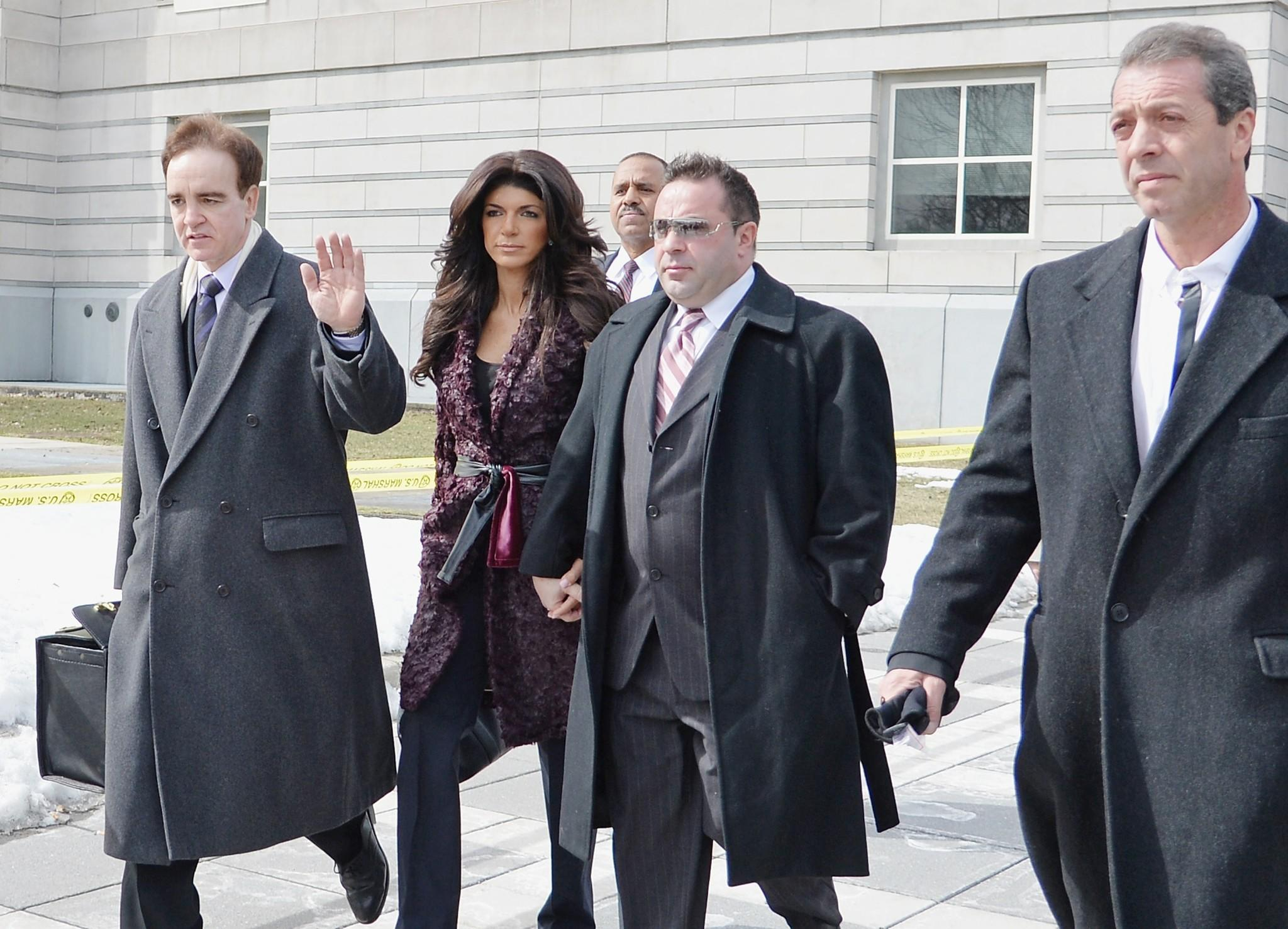 Teresa Giudice (L) and Joe Giudice leave court after facing charges of defrauding lenders, illegally obtaining mortgages and other loans as well as allegedly hiding assets and income during a bankruptcy case.