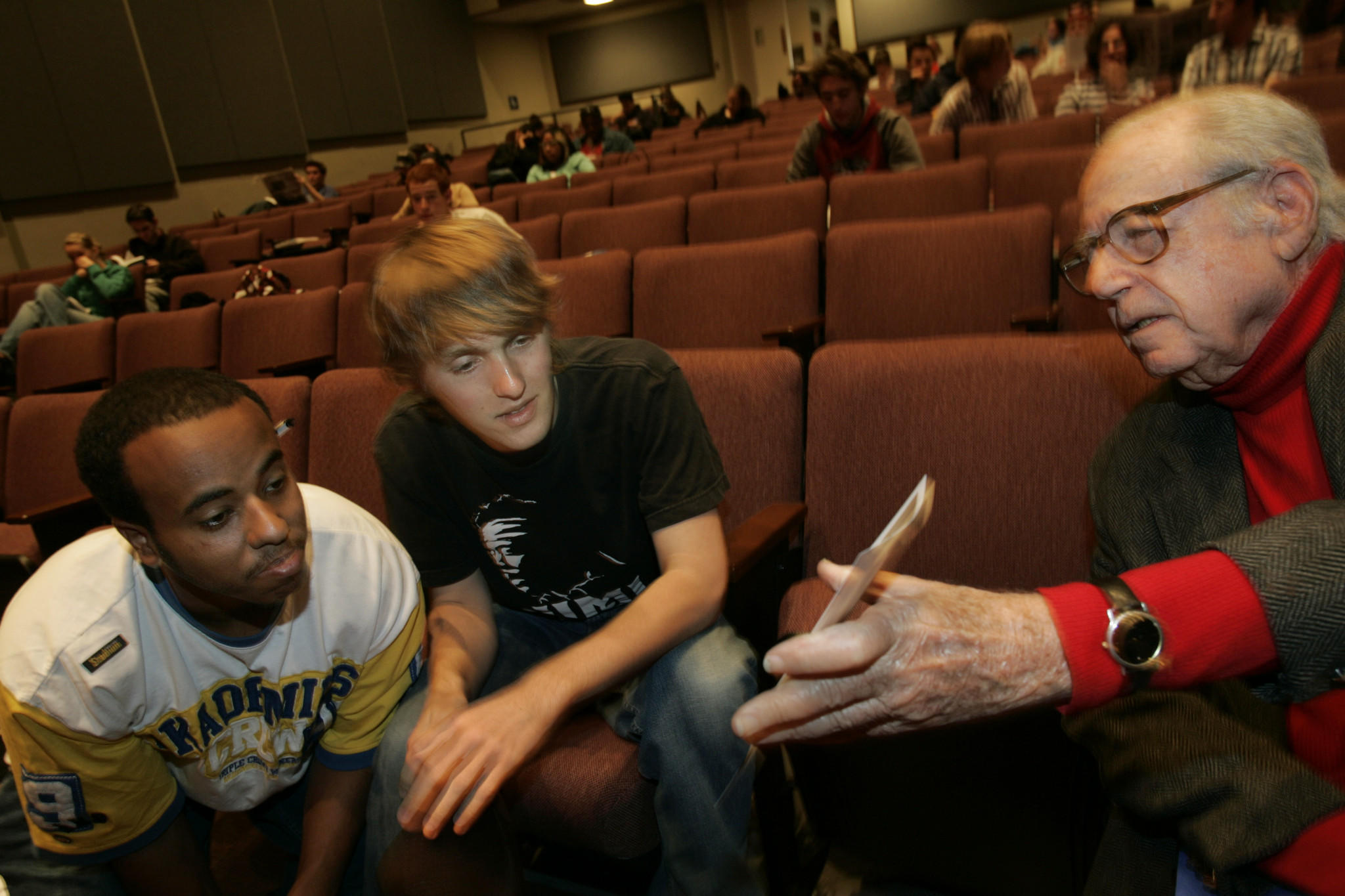 Writer-producer Stanley Rubin, right, speaks with fellow UCLA students Elias Male, left, and Marshall Knight in 2005.
