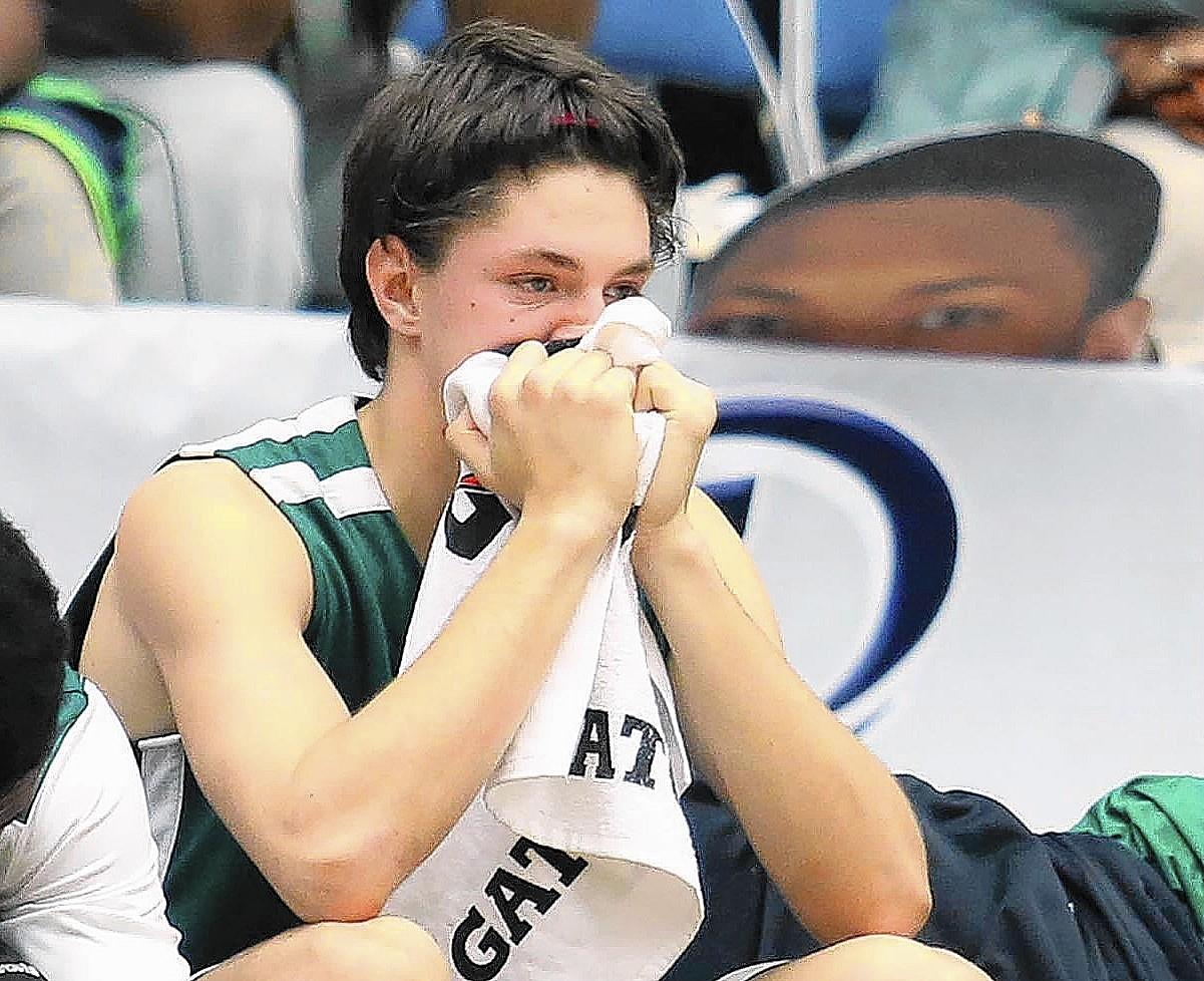 Lake Minneola forward Andrew Mendoza on the bench after losing the FHSAA Boys Basketball Class 6A state championship game of Lake Minneola versus Norland at the Lakeland Center in Lakeland on Saturday, March 1, 2014. Norland won the game 60-44.