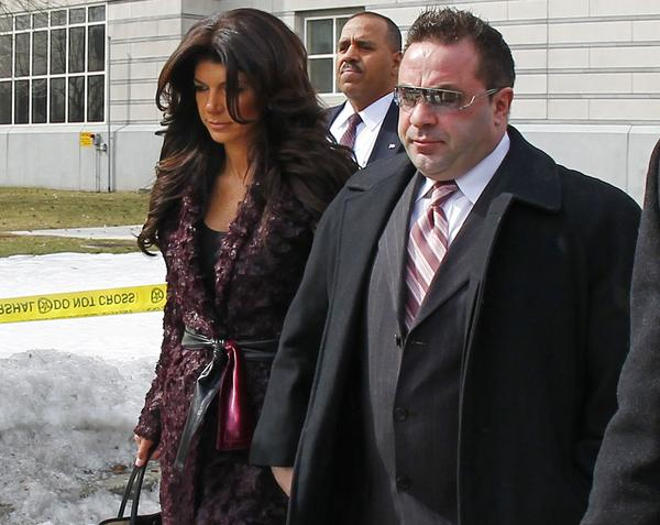"Teresa Giudice, left, and Joe Giudice, from ""The Real Housewives of New Jersey,"" leave federal court in Newark, N.J. They each pleaded guilty to several counts, including bankruptcy fraud, conspiracy to commit mail and wire fraud and failing to pay taxes."