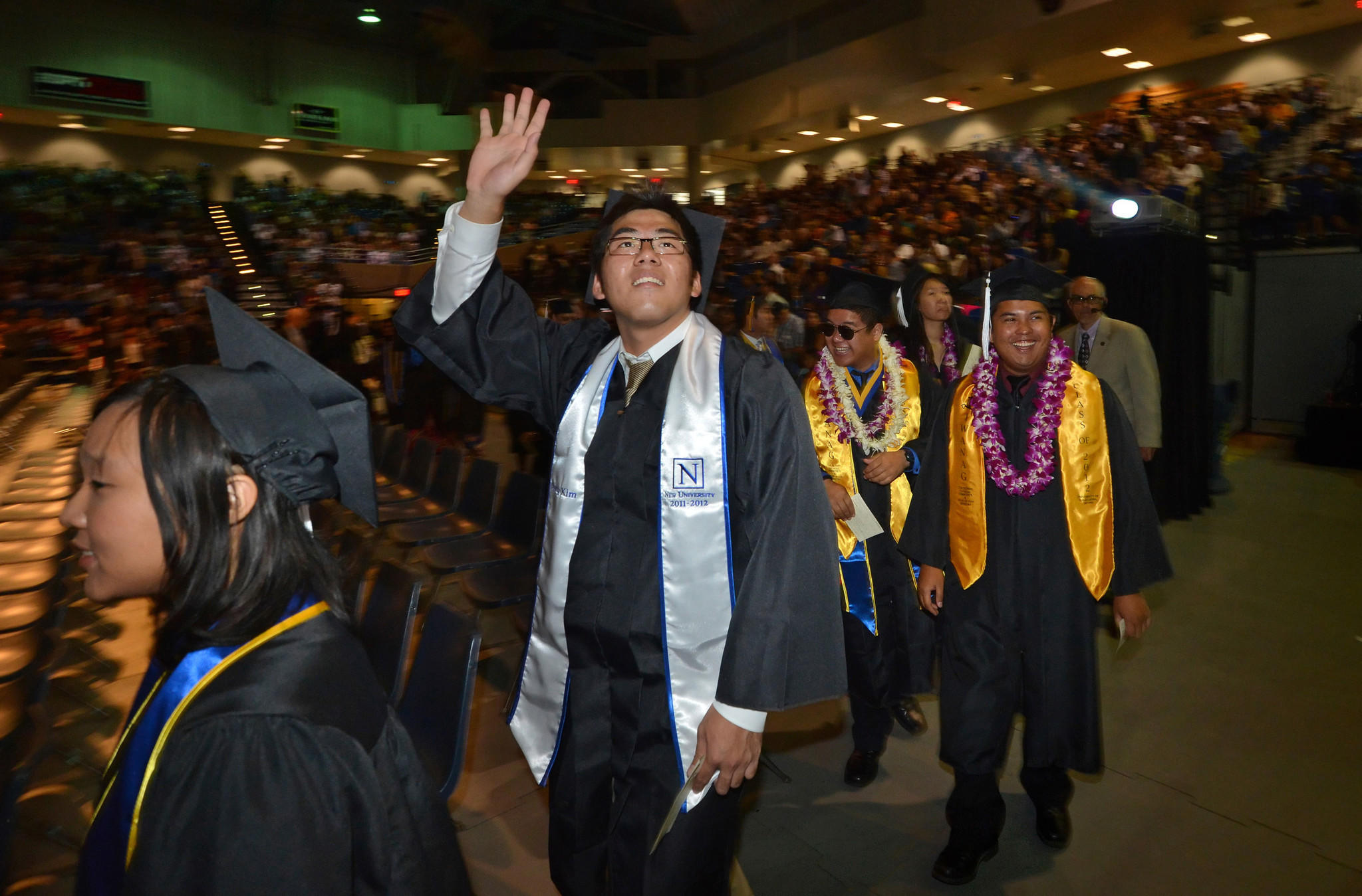 Students enter the Bren Events Center as a commencement ceremony for UC Irvine's School of Humanities gets underway in 2012.