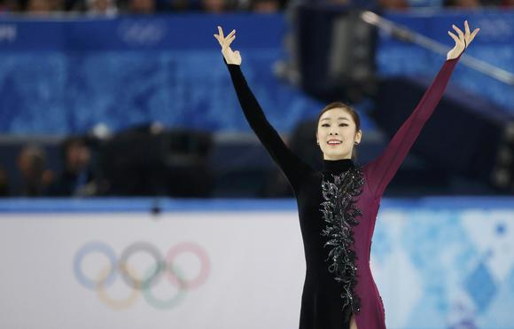 Yuna Kim salutes the crowd at the end of her Olympic free skate.