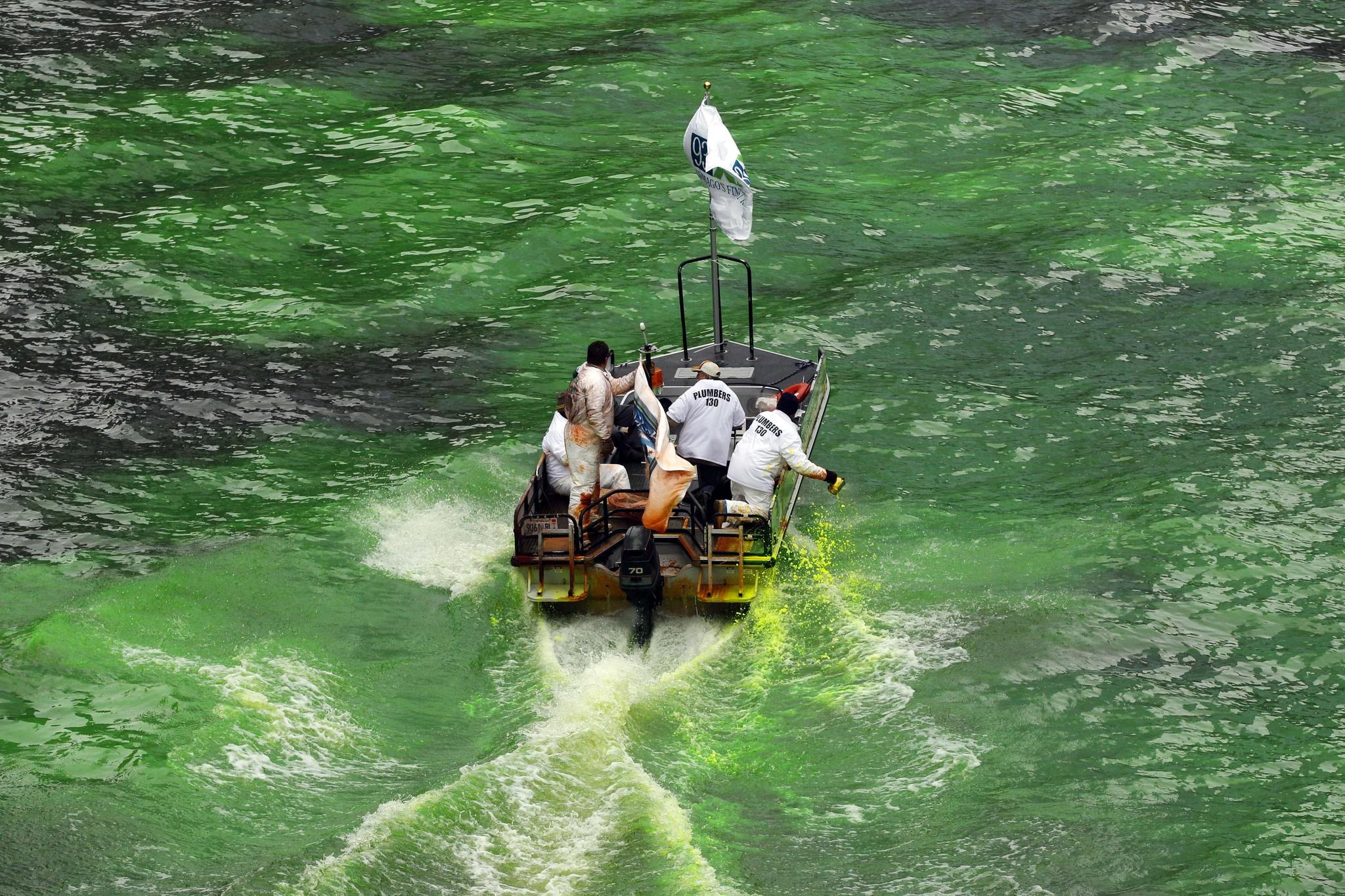 Members of Plumbers 130 union drop green dye into the Chicago River for St. Patrick's Day last year.