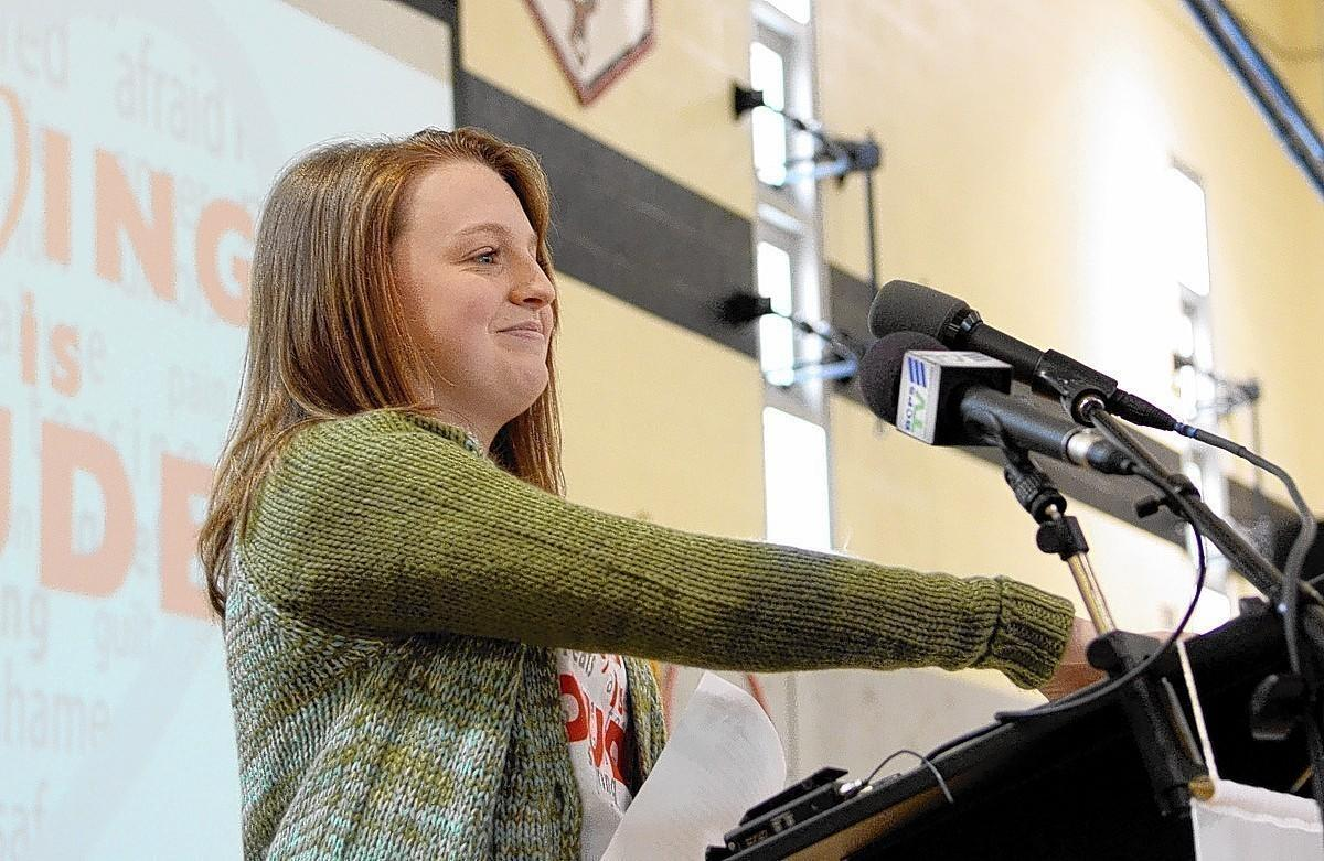 """Giulia Parsons, an eighth-grader at Ridgely Middle School in Timonium, speaks to her classmates at the kickoff celebration for Baltimore County Public School's Bullying Prevention Week Tuesday morning. Giulia wrote the campaign's slogan, """"Loving is Louder."""""""