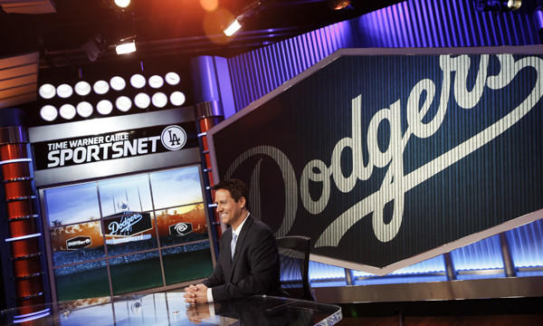 Anchor John Hartung sits in the SportsNet LA studio in El Segundo days before the network's official launch on Feb. 25. Not every Dodgers fan is cheering for the team's new cable channel.