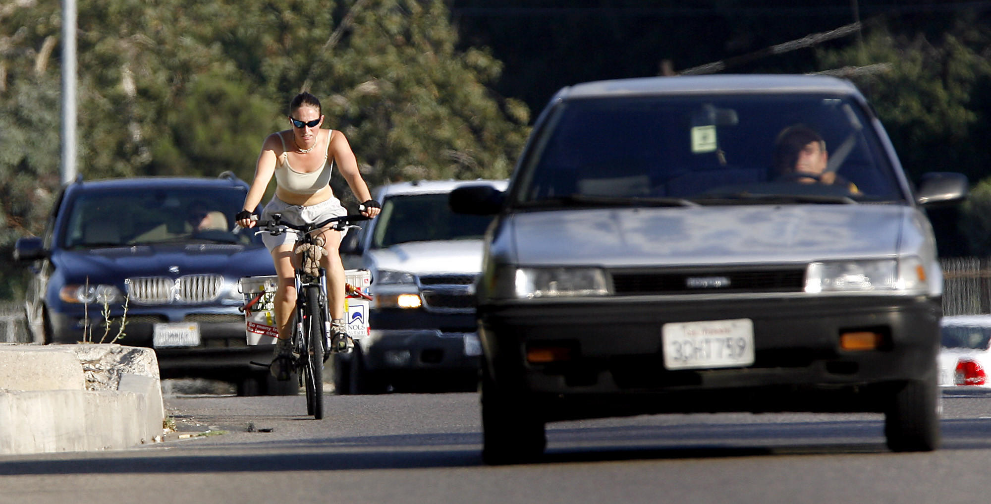 A bicyclist makes her way through traffic near the Glendale/Burbank/Griffith Park border Thursday July 31, 2008.