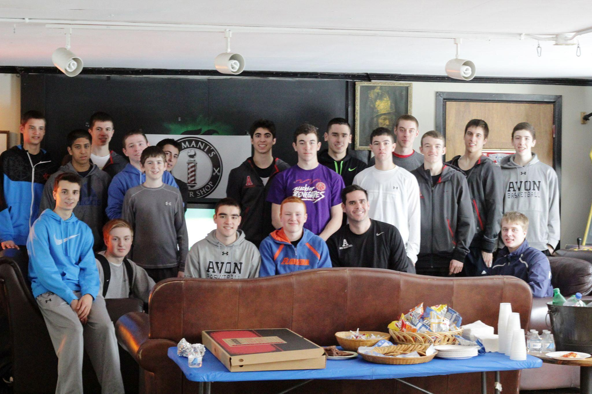 Avon Boys Basketball players team up with Lumani's Barber Shop in Avon to raise funds for Gifts of Love.