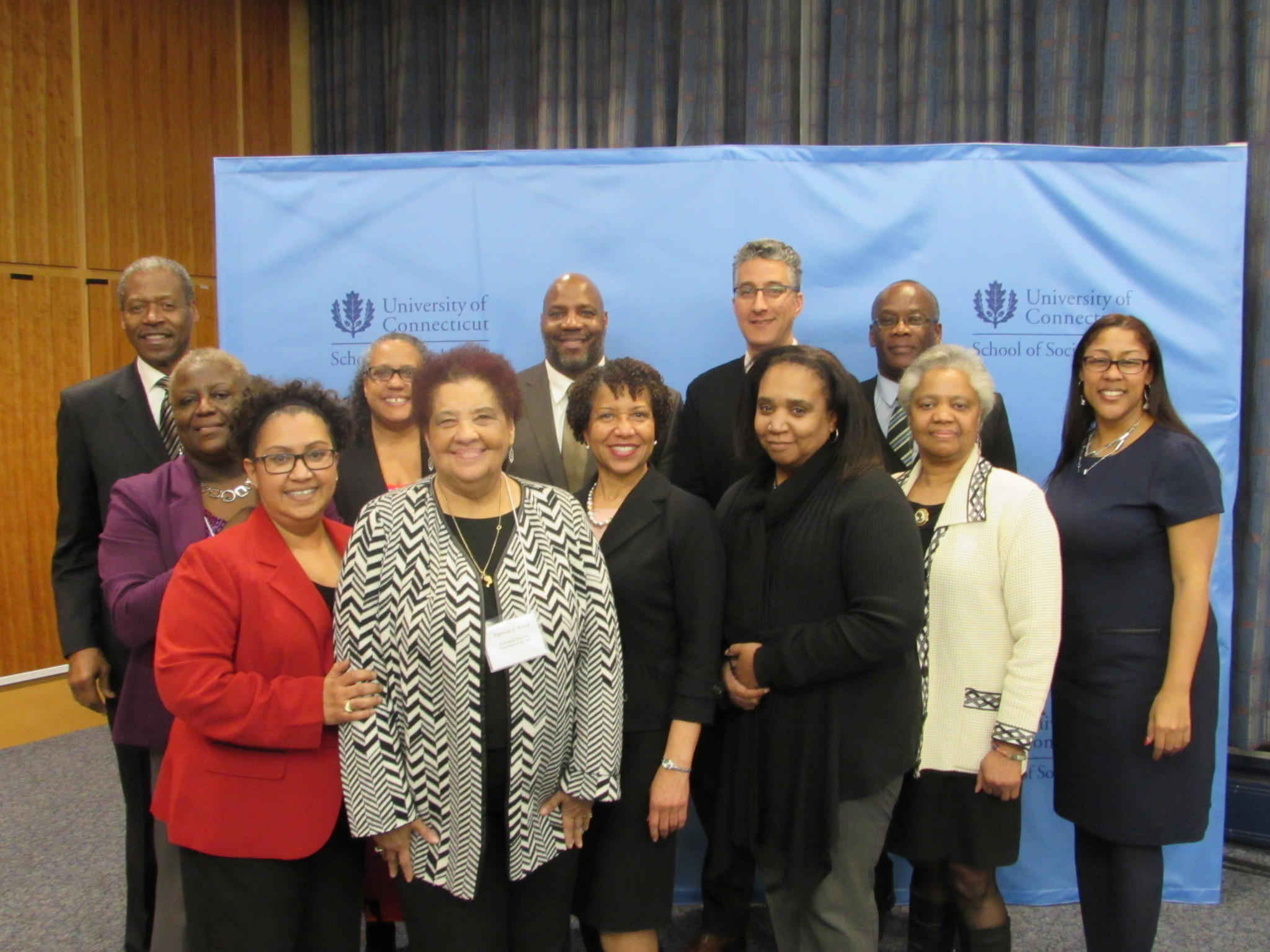Back row, from left to right: Senator Eric Coleman, Professor William Jelani Cobb, Associate Dean Scott Harding, Professor Barris Malcolm. Middle row, from left to right: Gloria Robinson, Professor Ann Marie Garran, Dean Salome Raheim, D'Lon Wilcox, Professor Edna Comer, Professor Kimberly Hardy. Front row, from left to right: Cheryl Jackson-Morris, Patricia Wrice.