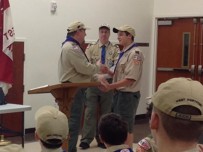 Andy Olmstead is congratulated by the Scoutmasters.