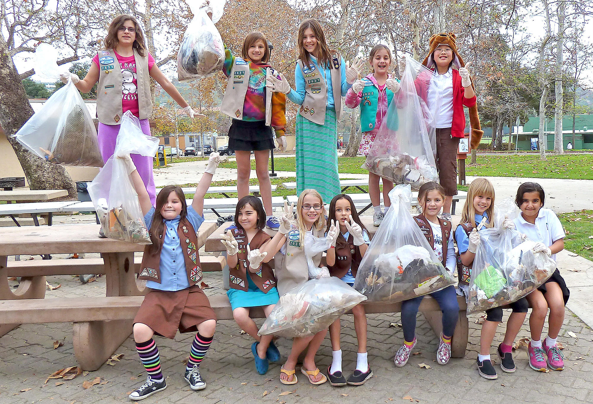 "Brownies in Girl Scout Troop 2631 spent a recent morning picking up trash at Verdugo Park as part of a project called ""Brownie Quest -- It's Your World -- Change It""."
