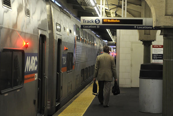 Passengers board a train to Washington at Baltimore's Penn Station, where some federal workers were on their way to Washington, D.C., returning to work