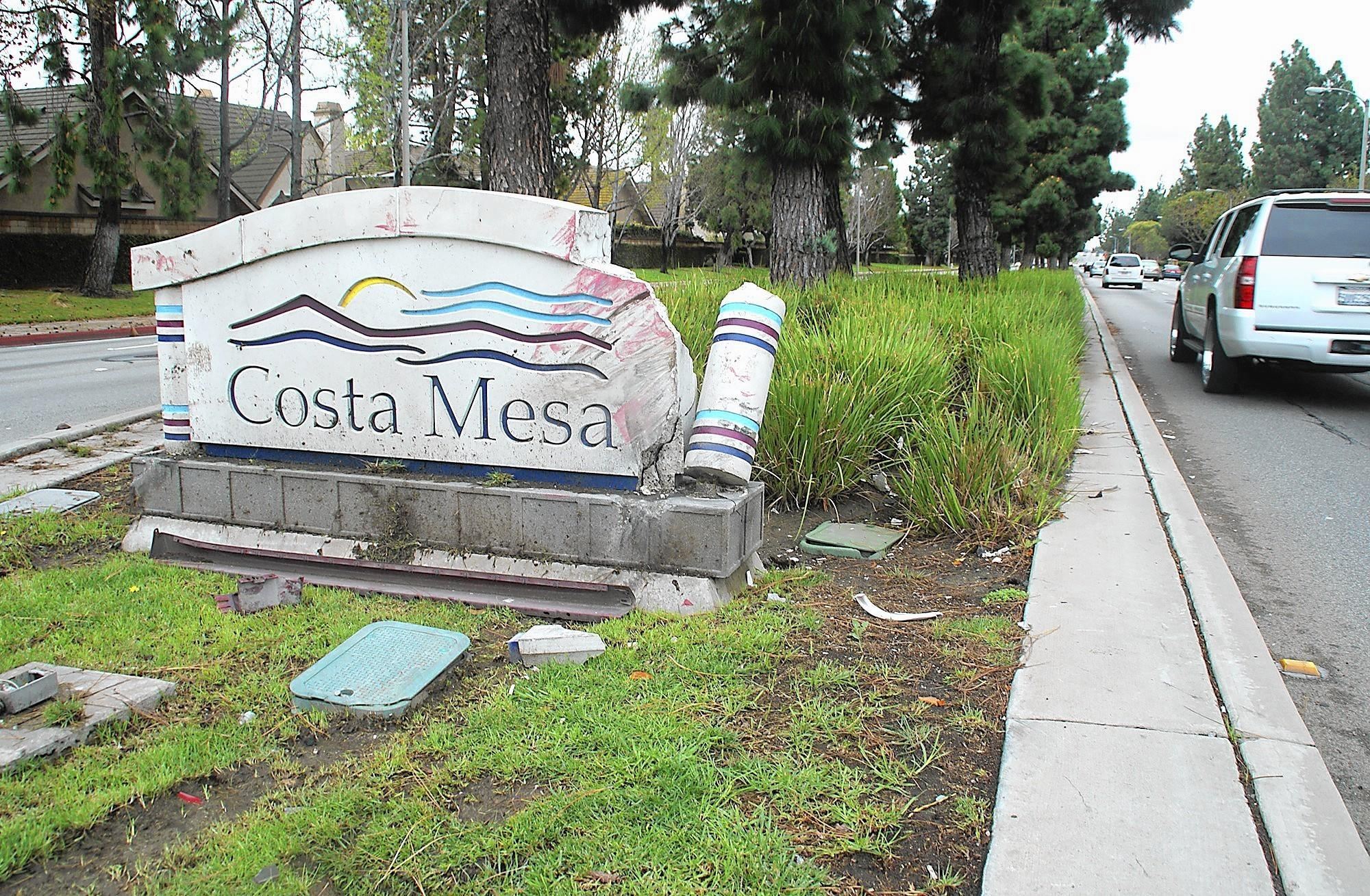 The city of Costa Mesa entry sign at Fairview Road and Sunflower Avenue was damaged Friday by a passing car.