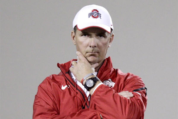 Ohio State Coach Urban Meyer concealed the scar from a surgery to drain a cyst on his brain under a hat at the Buckeyes' first spring practice Tuesday.