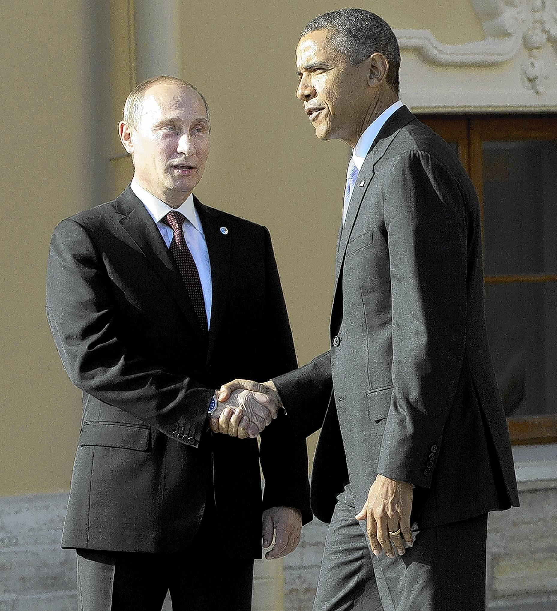 Russian President Vladimir Putin, left, welcomes U.S. President Barack Obama to September's G-20 summit in St. Petersburg, Russia.