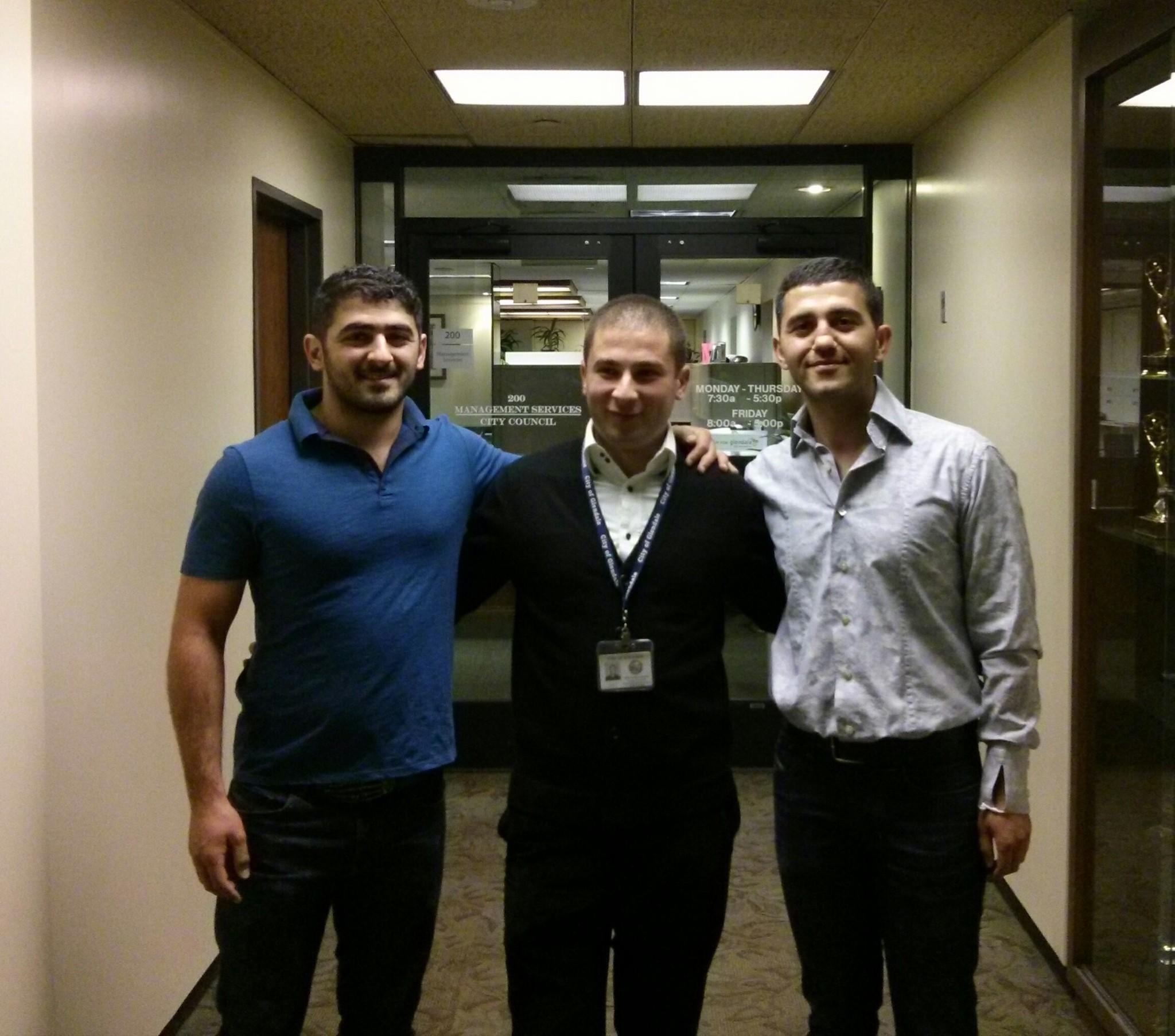 From right to left: Edgar Martirosyan, the man who delivered pizza to the Academy Awards Sunday night, poses at Glendale City Hall, alongside friend Artur Soghomyan and brother Erik Martirosyan.