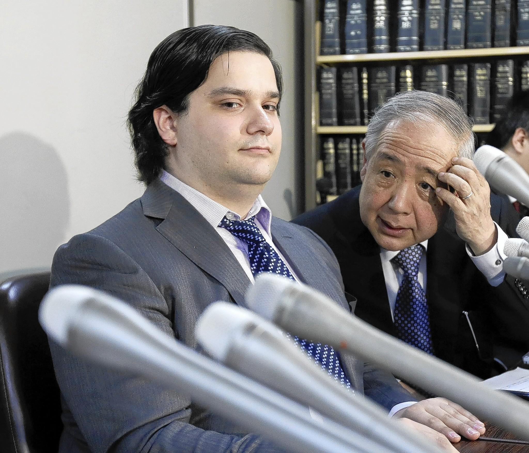 Mark Karpeles, left, is CEO of Mt. Gox in Tokyo, the world's largest exchange for trading bitcoins. Mt. Gox shut down last month, triggering a massive sell-off and sending away many prospective investors.