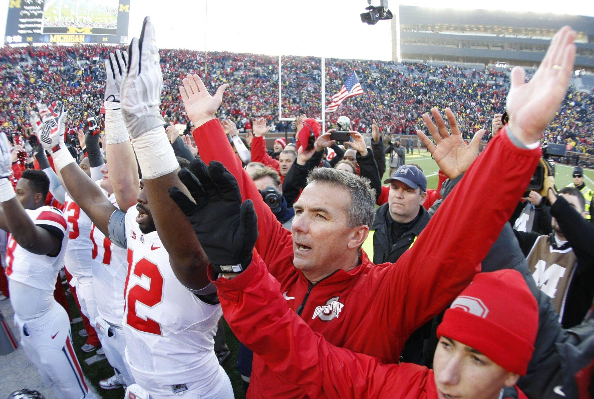 Ohio State coach Urban Meyer joins his team to sing the school's alma mater.