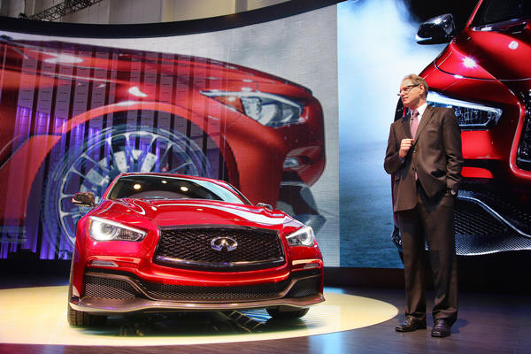 Johan de Nysschen, president of Infiniti, stands next to the 560-horsepower Q50 Eau Rouge concept at the 2014 Geneva Motor Show.