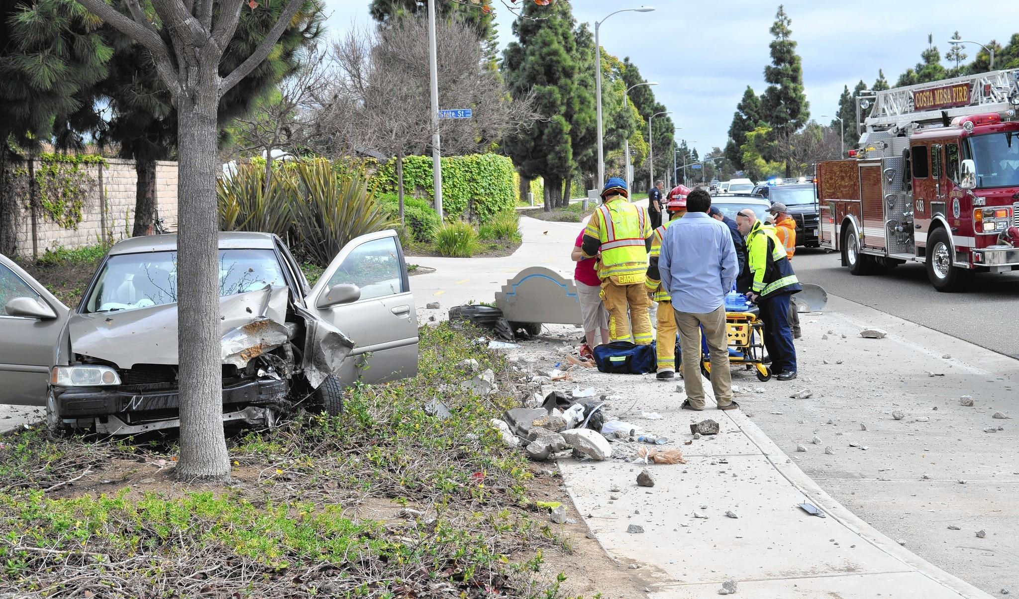 A Fountain Valley woman was taken to an area hospital Tuesday morning for minor injuries after crashing her car into a utility pole, concrete bench and trash can along Victoria Street near American Avenue.