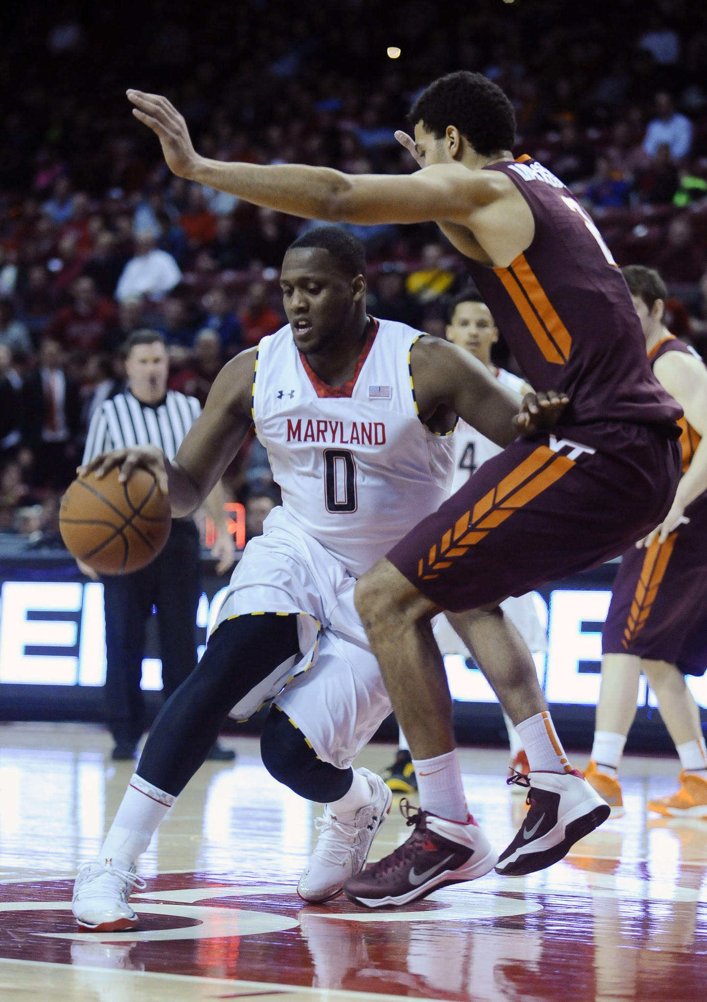 Charles Mitchell drives against Virginia Tech's Joey Van Zegeren in the first half.