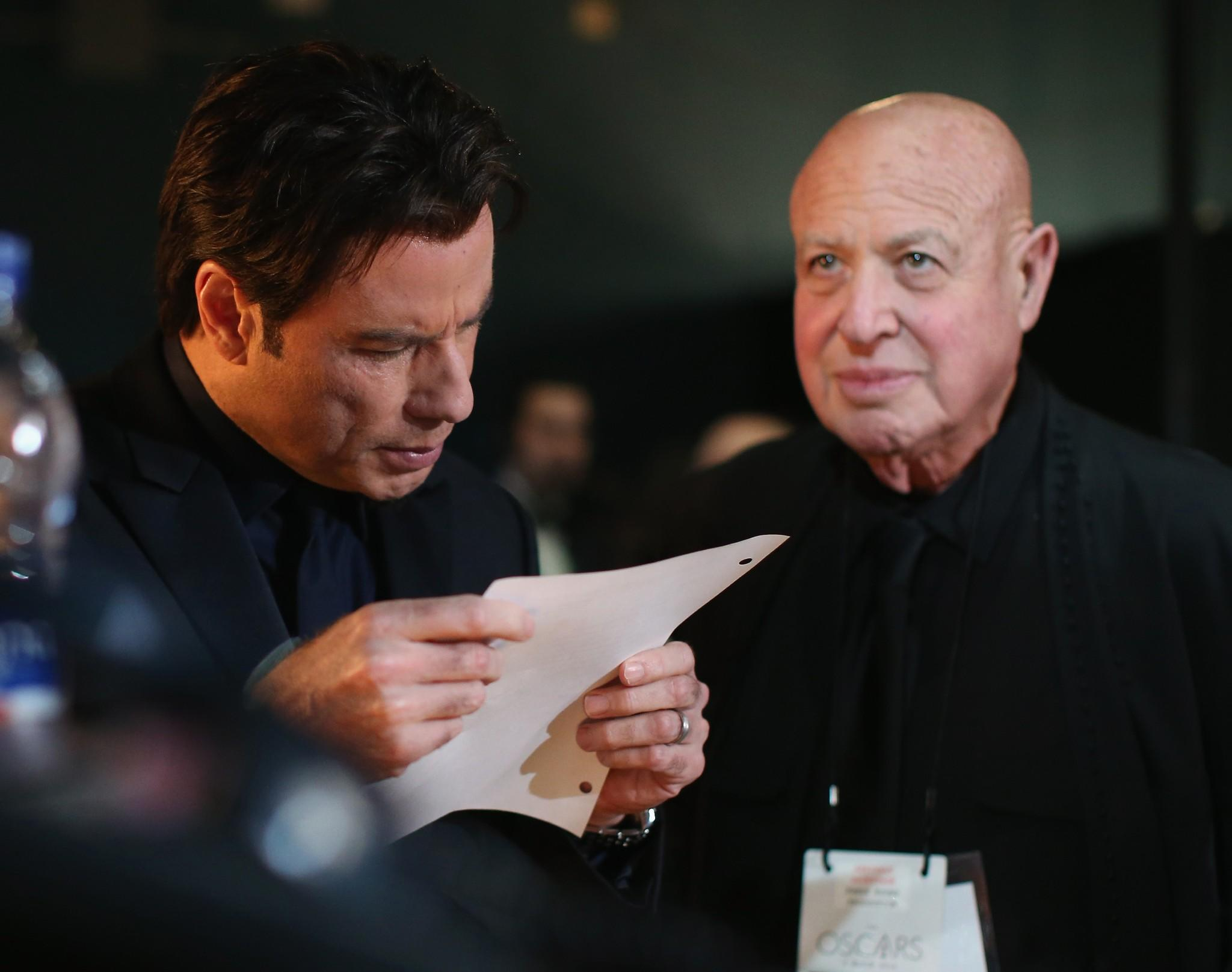 Actor John Travolta and publicist Paul Bloch backstage at the Oscars.