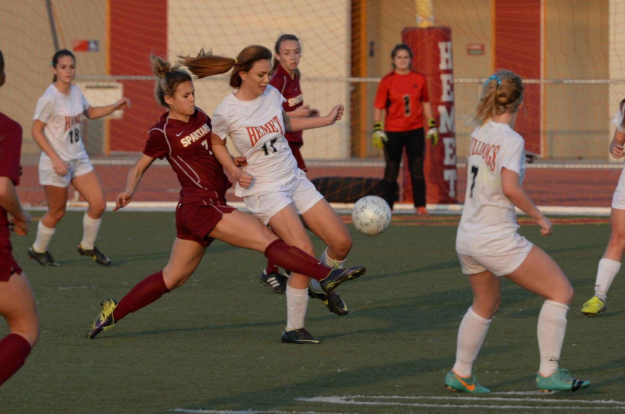 La Cañada High's Megan Decker (7) attempts to bypass the defense of Hemet in Tuesday afternoon's CIF Southern Section Division V girls' soccer semifinal match. The Spartans won, 2-0. (Courtesy of Doug Brown)
