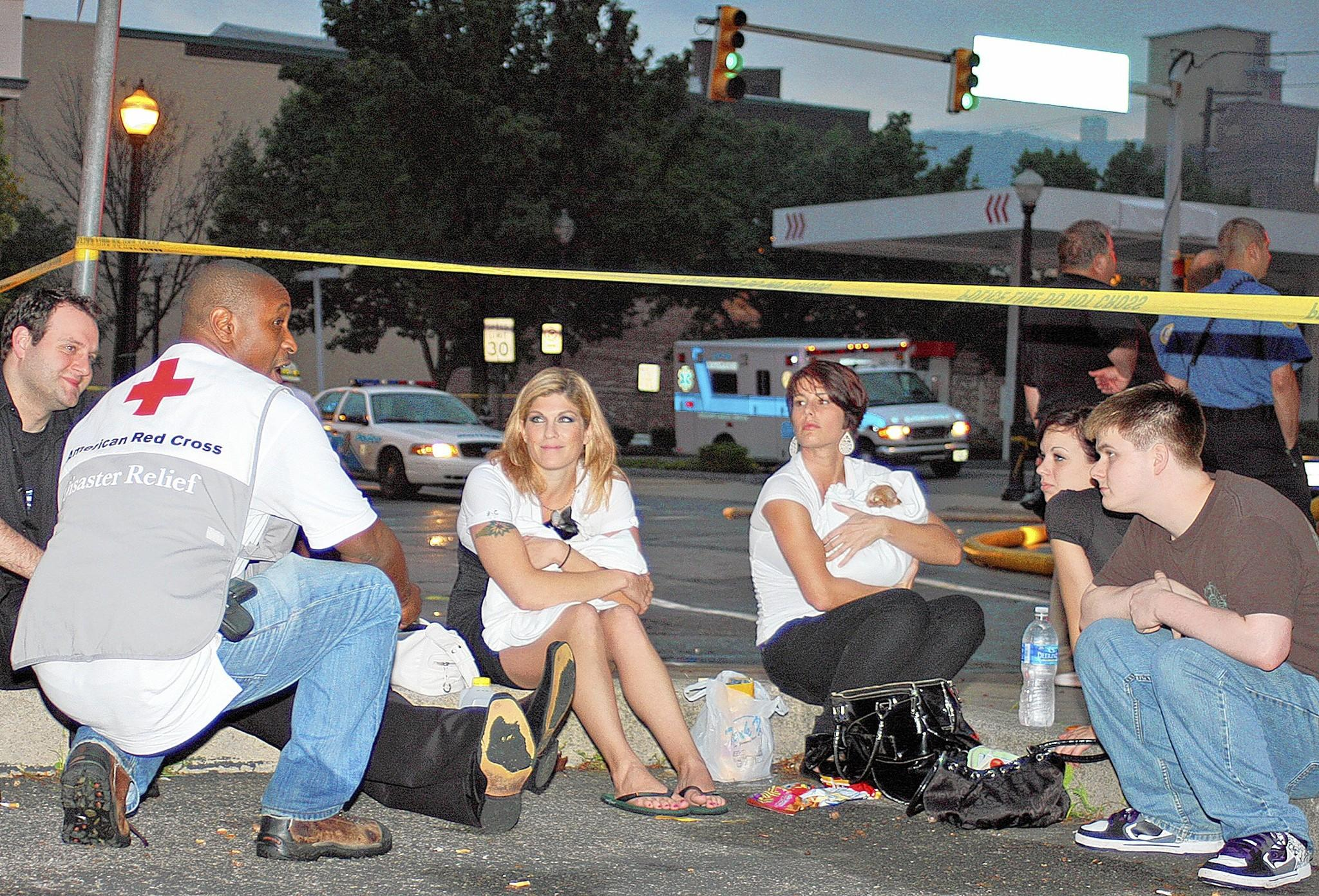 A representative of the American Red Cross, Greater Lehigh Valley Chapter, talks to people displaced from an apartment fire at 2 W. Third St., Bethlehem, in 2011.