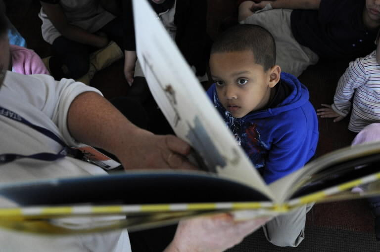 Elijah Briscoe, 5, pays close attention to Hartford Public Library children's department assistant Auden DiCorcia-D'Amato during a story hour in 2010.