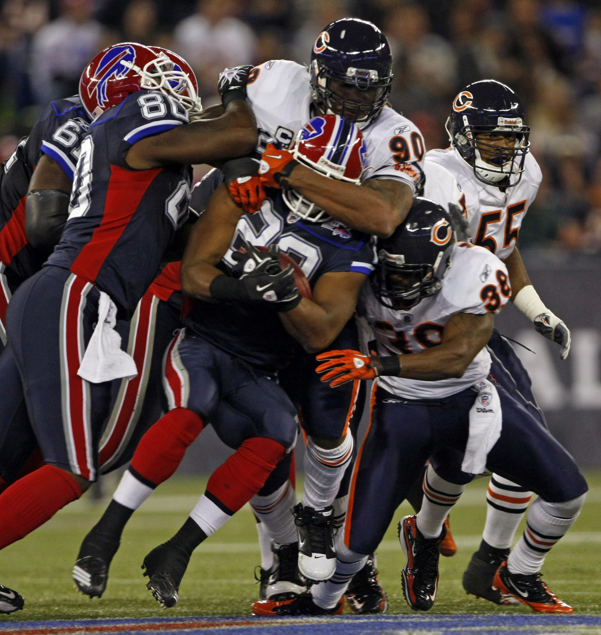 The Bears' Julius Peppers envelopes the Bills' Fred Jackson during a 2010 game at Rogers Centre in Toronto.