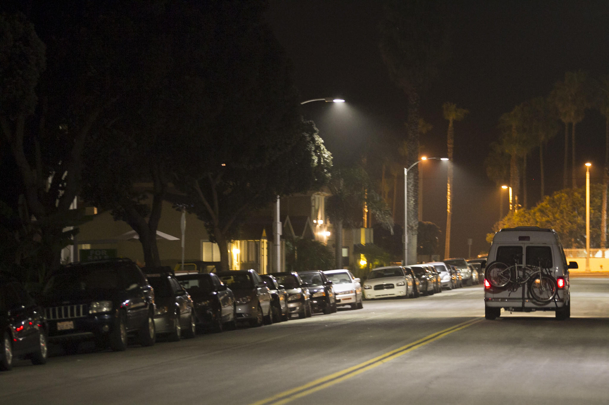 Cars line the street at Seventh Street in between Walnut and Orange avenues.