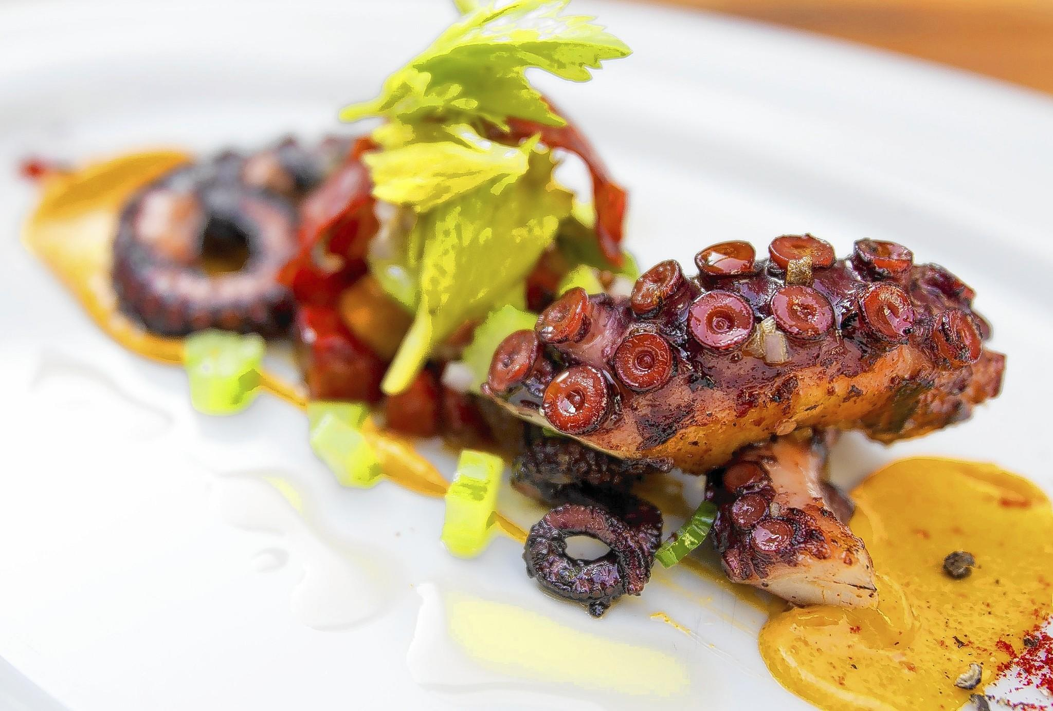The roasted wild Spanish octopus with chorizo emulsion, celery, potatoes, chorizo, lemon and huile d'olive 16 at Marche Moderne.