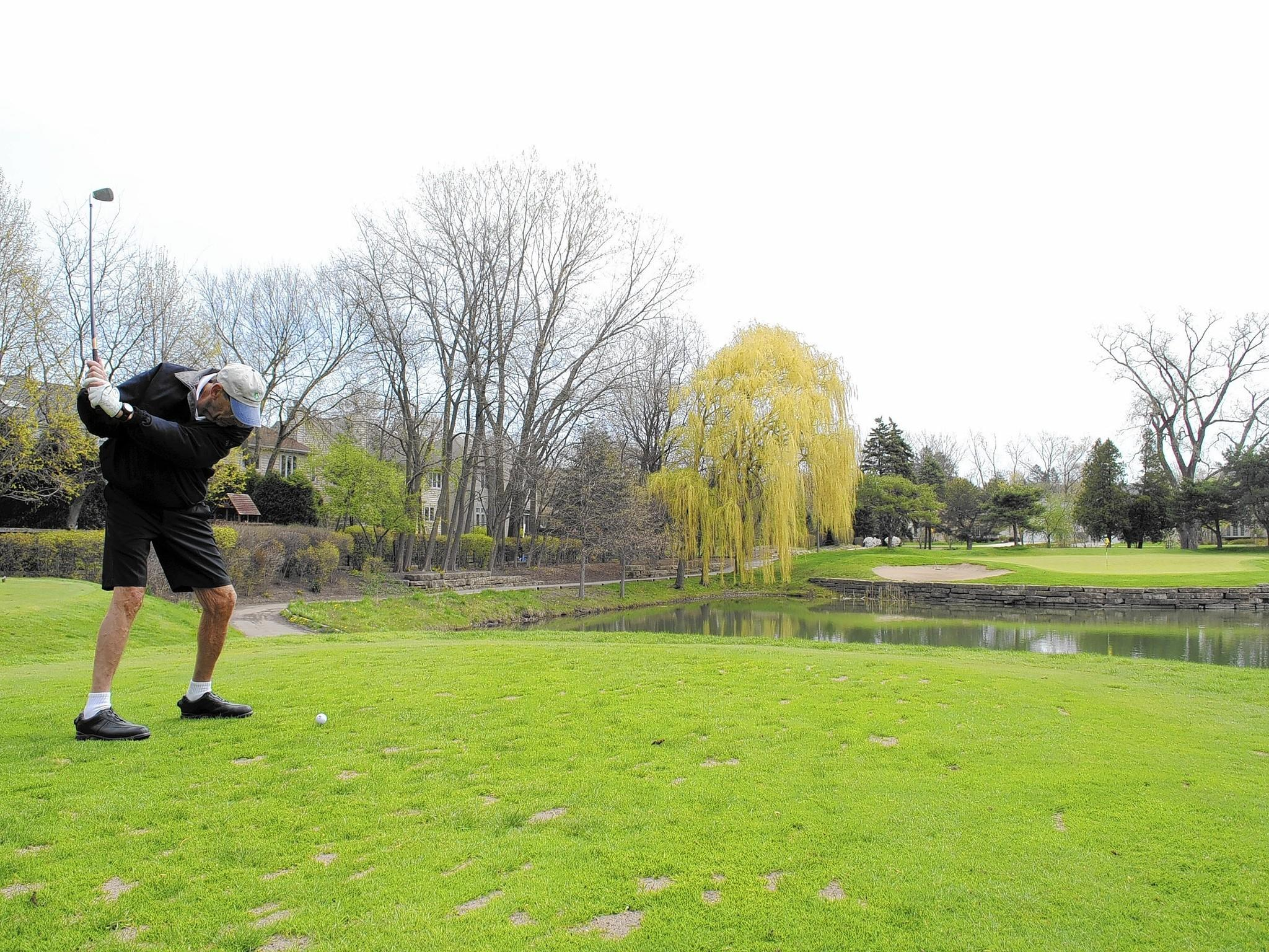 In the Tribune file photo, a golfer tees off on the par-3 5th hole at Highland Park Country Club in May 2013.