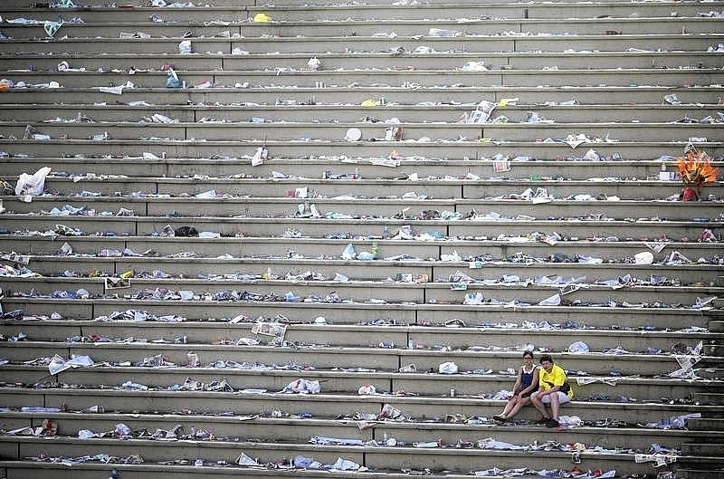 Revellers rest in a nearly empty Sambadrome after the end of the annual Carnival parade in Rio de Janeiro.