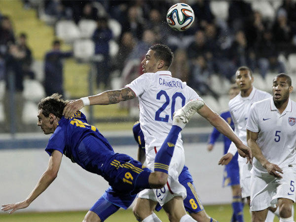 Ukraine's Denys Garmash, left, goes after the ball against Geoff Cameron of the U.S. during an international friendly match at Antonis Papadopoulos stadium in Cyprus.