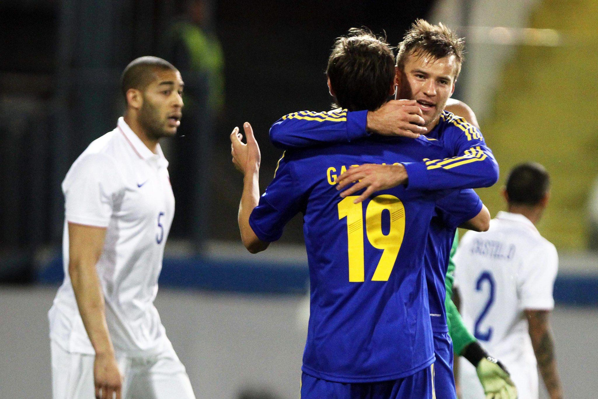 Ukraine's Andriy Yarmolenko (right) celebrates with his teammate Denys Garmash after scoring the game's first goal.